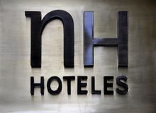 Hotel brand logo. NH Hotels brand logo in Florence, Italy stock photos