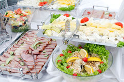 Hotel breakfast. With various cheeses, cured meats and salads Stock Photos