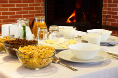 Hotel breakfast near the fireplace comfort Stock Photography