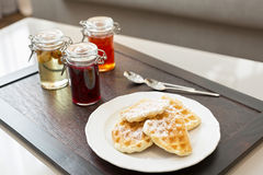 Hotel breakfast served on wooden tray Stock Photo