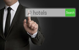 Hotel browser is operated by businessman Royalty Free Stock Photography