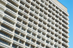 Hotel building. Exterior of prematurely aged white hotel building Stock Image