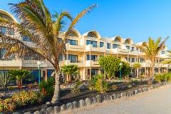 Hotel building along coastal promenade in Playa Blanca Royalty Free Stock Photos