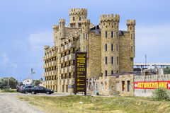 The hotel building, covered with decorative stone. Multi-storey hotel with a decorative trim, which is called Dagestani stone. Stock Photography