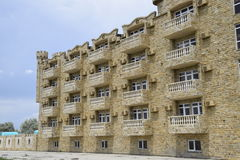The hotel building, covered with decorative stone Stock Photo