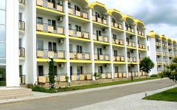Hotel building exterior. Apartment building facade. yellow balconies Royalty Free Stock Photos
