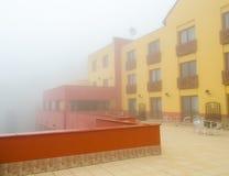Hotel building in fog