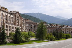 Hotel building in Gorki ?ity and mountains. Sochi, Russia. Sochi, Russia - August 23, 2016: View of the hotel building in Gorki ?ity on the background of the stock photography