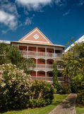 Hotel building in lush gardens, Bahamas Royalty Free Stock Photo