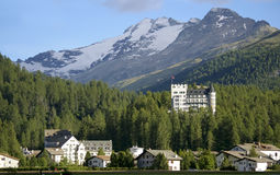 Hotel building  mountain resort davos switzerland. Hotel building in mountain resort davos switzerland with impressive peak and glacier in background Stock Photo