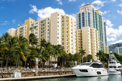 Hotel buildings with yachts and palm trees Royalty Free Stock Image