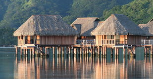 Hotel bungalows over Moorea lagoon. Sunrise Royalty Free Stock Photography