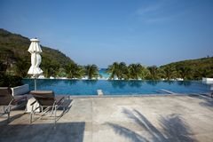 Hotel with bungalows, palm trees on the  beach,  Royalty Free Stock Images