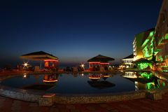 Hotel, cafe and pool in night Royalty Free Stock Image