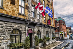 Hotel Champs de Mars. Nestled among other historic buildings at the gateway to Old Montreal, Hotel Champ de Mars offers a prime location, an inviting and warm Stock Photography