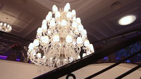 A hotel chandelier. Vintage chandelier in the hotel, interior stock video footage