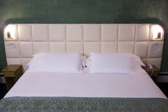 Hotel clean blank bed Stock Images