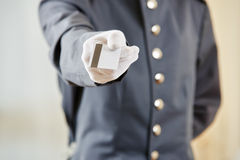 Hotel clerk offering key card Stock Photography