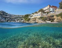 Hotel coast neptune grass underwater Spain. Hotel on the Mediterranean coast of Spain and neptune grass underwater sea, split view above and below water surface Stock Photo