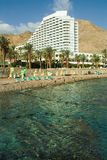 Hotel on a coast of Red sea. Magnificent modern hotel on a background of ancient hills on resort Eilat in Israel Stock Image