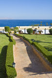 Hotel complex by ocean. Paved walkway leading to hotel complex by ocean, Sharm el Sheikh, Egypt Stock Photography