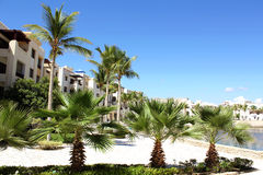 Hotel complex. Outside hotel complex with the palms and sea. Oman Salalah Royalty Free Stock Photos