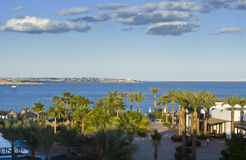 Hotel complex by Red Sea. Scenic view of hotel complex with palm trees by ocean, Sharm el Sheikh, Egypt Stock Photos