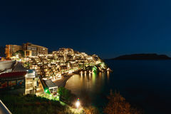 Hotel complex for rich people Dukley Gardens in Budva, Montenegr. O. Night photo at the full moon, starry sky Royalty Free Stock Image