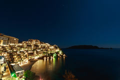 Hotel complex for rich people Dukley Gardens in Budva, Montenegr. O. Night photo at the full moon, starry sky Stock Photos