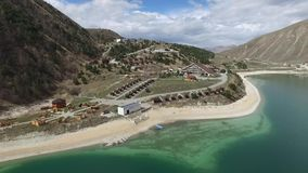Hotel complex on the shore of Lake Kezenoy am. Chechen Republic. Russia stock video footage