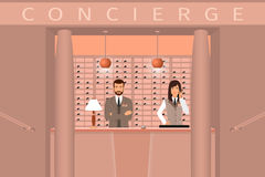Hotel concierge service. Front view of concierge counter with two hotel employee. Stock Photography