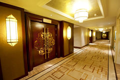 Hotel corridor. Luxury hotel corridor with decorative doors and lamps Royalty Free Stock Images