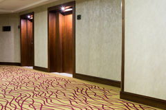 Hotel corridor with carpet Stock Images