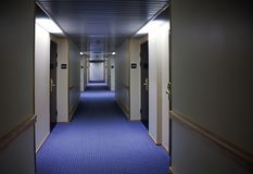 Hotel corridor interior. Abstract dark hotel corridor interior with doors and room numbers Royalty Free Stock Photography