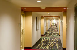Hotel corridor interior. Hotel corridor interior with carpet. Empty hotel hallway Royalty Free Stock Images