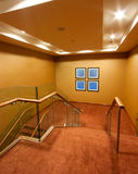 Hotel Corridor interior with stairs. Carpet and wooden railings Stock Photography