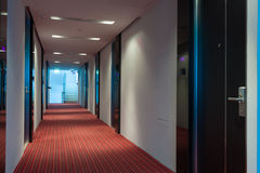 Hotel corridor. Modern hotel corridor with red brown capet to exit stairway Royalty Free Stock Photos