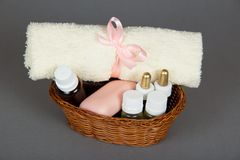 Hotel cosmetics kit and terry towel in basket Stock Images