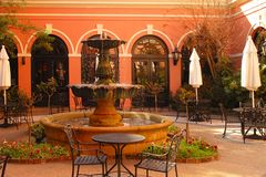Hotel courtyard. Courtyard with beautiful fountain, plants and arches with spanish atmosphere Stock Images