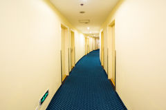 Hotel curved corridor. With blue carpet Royalty Free Stock Image