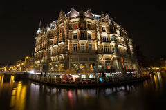 Hotel de l'Europe. At night as seen from across the Amstel river Stock Image