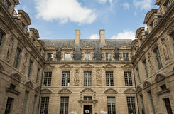 The Hotel de Sully, Paris, France. The Hotel de Sully, its mannerist monumental ornamental motifs are representative of the late Rennaissance: heads of women Stock Photos