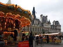Hotel de Ville with a carousel in christmastime, Paris, France stock photography