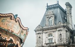 Hotel de Ville with Foreground Carousel stock photo