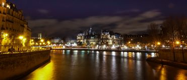 Hotel de ville city town hall of Paris at night, with Seine river in the foreground, taken from Ile de la Cite Royalty Free Stock Photography