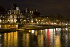 Hotel de Ville and Seine river. Hotel de Ville (City Hall of Paris) and Seine river at night, Paris, France Stock Photos