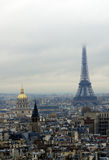 Hotel des invalides and Eiffel tour (tower) in fog. Paris`s view from the top of Notre Dame de Paris. Hotel des invalides and Eiffel tower in fog Royalty Free Stock Images