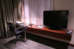Hotel desk and reading lamp. Dictionary on the desk with reading lamp turning on Stock Image