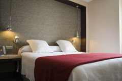 Hotel_detail. Cross-view of a hotel room, with bed area featured Royalty Free Stock Images