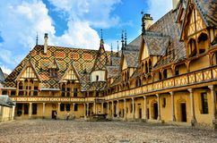 Hotel Dieu, Beaune, France. Iconic courtyard of Hotel Dieu, Beaune, France Royalty Free Stock Image